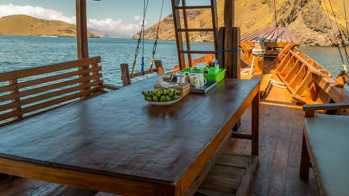 Alcira Boat Phinisi Dinning area table lunch dinner Komodo