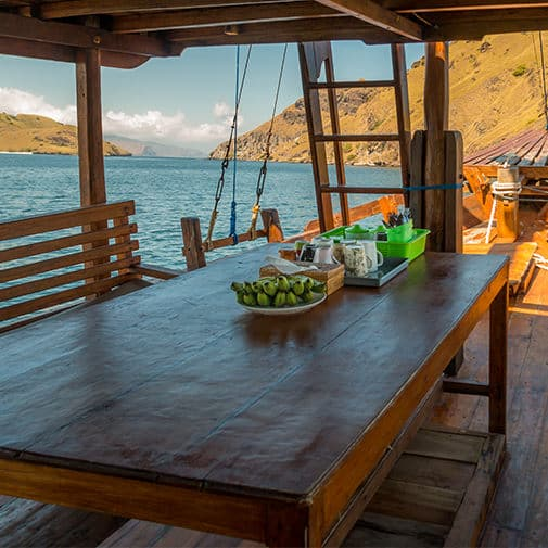 Alcira Phinisi Boat Komodo Labuan Bajo Table lunch dinner